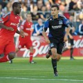 Chris Wondolowski tracks Toronto FC's Nana Attakora.