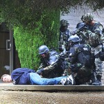 The Santa Clara County SWAT team disarms a 'suspect' during training.
