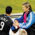 Earthquake coach Frank Yallop (right) dons a pink neck scarf for Breast Cancer Awareness month.