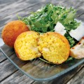 One of the many treats at Tootsie's in the historic Stanford barn is saffron rice with mozzarella and an arugula salad.