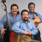 "Louis ""Moon"" Kauakahi on 6-string guitar, John Koko on bass and Jerome Koko on the 12-string. (video)"
