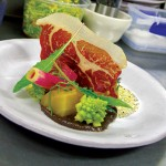 """At Station 1,  """"pig in the garden"""" features dried prosciutto with golden beets, romanesco and radish curls."""