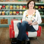 """Sweet Shop manager Sandy Colunga sits before the """"wall of candy."""""""