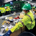 Some of the sorting at the ingeniously mechanized GreenWaste facility still must be done by hand.