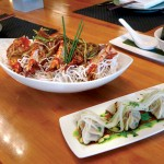 Tamarine features creative pairings like prawns and lamb pot stickers.