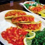 The bacalhau tacos span two cuisines.