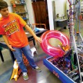Ethan Anderson, a junior at Woodside High School, explains the functionality of G-Wrath, a robot students built to catapult objects long distances.