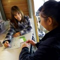 HUNGRY FOR HELP  CalFresh Outreach Manager Nicole Martinez (left) helps people sign up for food stamps at the Second Harvest Mobile home office.
