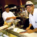 Chefs Noriomi Kaneko (left) and Ichiro Takahashi slice and dice with great skill.