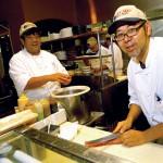 Chefs Noriomi Kaneko (left) and Ichiro Takahashi slice and dice with great skill.