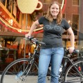 San Jose Bike Party organizer Katie Heaney in front of her wheels on South First Street.