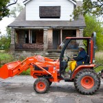 LOW MILEAGE, HIGH IDEALS  Edith Floyd, founder of 'Growing Joy' gardens in Detroit, drives her shiny new bright orange Kubota tractor down her street where she is reclaiming the empty lots and growing food.