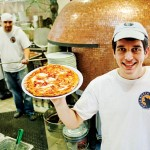 BETTER PLATE THAN NEVER:  Tyler Raynes shows off the Diavola pizza, which comes out of the custom oven at Bocca Lupo in about 90 seconds. Photograph by Jessica Shirley-Donnelly