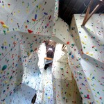 UPWARD BOUND: The new climbing wall at Touchstone takes advantage of the old movie theater's high ceiling.