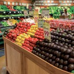 CORNUCOPIA: The aisles at the Evergreen New Leaf are filled with the color of spring produce. Photograph by Aron Cooperman