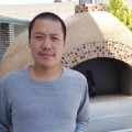 PIZZA TO GO: Bare Knuckle Pizza owner Viet Nguyen serves artisanal pizza with a mobile pizza oven.