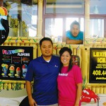 ROLLING TREATS: Young Huh and his wife, Lien Bui, along with brother-in-law Thanh Bui (in truck) keep Kona Ice cool.