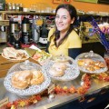 NOW FOR SOMETHING DIFFERENT: Yeganeh Riazi works the counter at her namesake bakery. Photograph by Alex Stover