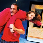 PAJAMA GAME: Rachel (Halsey Varady) learns some Scrooge-like truths about her husband, Tom (Will Springhorn, Jr.), in 'Reckless.'