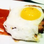 EXTRA TREAT: LB Steak's maple-glazed pork belly is topped with a fried egg.
