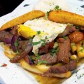 PERUVIAN WITH A TWIST: Lomo Saltado a lo Zenon features fried eggs and plantains.