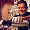 Bartender Eric Nielsen pours a cocktail at 55 South.