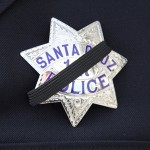Officers wore a black band over their badges Thursday in honor of two Santa Cruz police officers, Loran Baker and Officer Elizabeth Butler, who were killed in the line of duty. (Photo by Matt Crawford)