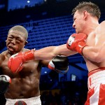 THE LONG REACH OF THE GHOST: Robert Guerrero delivers a hard right to Andre Berto in 2012. Photograph by Naoki Fukuda