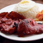 UNEXPECTED The tocino marries papaya, rice and an egg. Photograph by Kristine Bautista