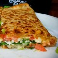 SPECIAL STUFF: Delicious Crepes Bistro packs the Special Crepe with plenty of spinach, tomatoes and cheese. Photograph by Amy K. Buchanan