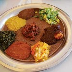 BREAD PLATE: At Walia, vegetable or meat stews called wot are served atop injera bread. Diners tear off pieces of the bread to scoop up bites of wot.