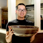 Darren Nguyen, owner of Pho 69, stands behind his Big Bowl Challenge.