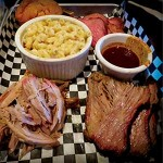 HAVE A SMOKE: Tri-tip, brisket and pulled pork are among the choices for Smoke 'N Wings' Smoked Meat Combo, which also comes with a cornbread muffin and a side—in this case, mac'n'cheese.