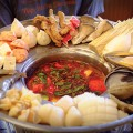 DIY SOUP  Lau Hai San's Spicy Thai Seafood hot pot is served with an array of seafood, mushrooms and tofu on the side that diners cook in the hot broth. Photograph by Amy K. Buchanan