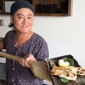 Iroriya's chef Yoshiyuki Maruyama shows off a fish dish hot off the charcoal grill.