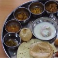 A thali is a traditional large, steel serving tray used to present a number of katori, small cookery bowls.