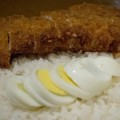 Katsu curry at Muracci's features a breaded pork cutlet topped with curry sauce (optional egg) and served with rice.