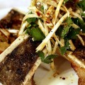 TO THE BONE: Searing hot bones with 'rich and buttery' marrow delight in the old-school vibe of Orchestria Palm Court.