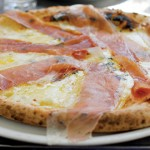 Doppio Zero Pizzeria Napoletana's three-cheese white pizza, the Bianca, gets an additional boost with thin slices of prosciutto. Photo by Ngoc Ngo.