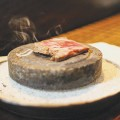 HOT PLATE: Mouth-watering marbled short ribs are grilled in front of customers on a heated stone.