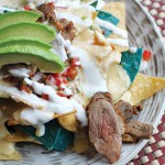 DUCK QUICK: The Socialight's duck nachos appetizer pairs deliciously with pepper jack and crema.