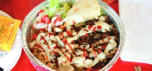 GET SAUCED: The Halal Guys chicken and rice dish is served with their special red and white sauces.
