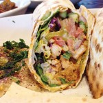 WRAPPING FORTE: Dish N Dash has a slick ambience and beer selection, but don't forget favorites like the chicken shawarma.
