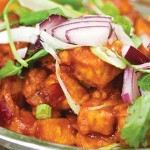 The decadent Chilli Paneer combines sweet and spicy tomato sauce with fried of chunks of cheese.