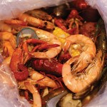 Big bags of seafood are best shared party-style—which may or may not require a post-dinner visit to the laundromat. Photo by Ngoc Ngo.