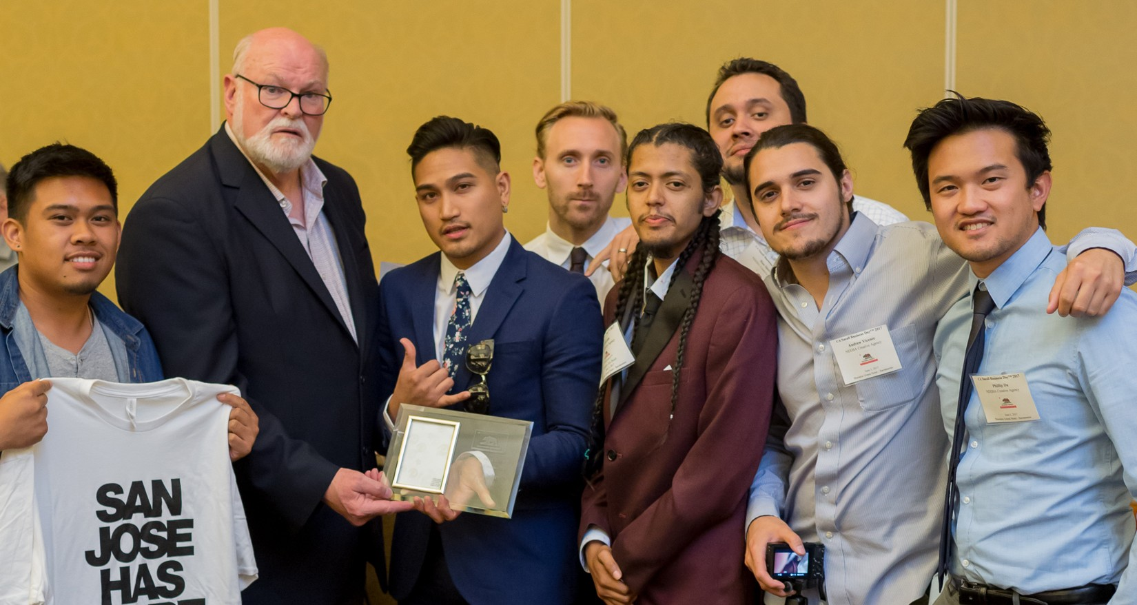 State Senator Jim Beall, second from left, presented NEEBA with a Small Business of the Year award the company's work in telling community stories through video and production.