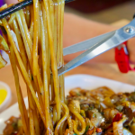 Paik's serves up noodle dishes that actually require shears to cut them down to a manageable size. (Photo by John Dyke)