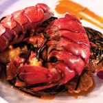 TRUE LOVE EATS: The squid-ink pasta with lobster tails is one of Trattoria's more popular dishes. Photo by John Dyke